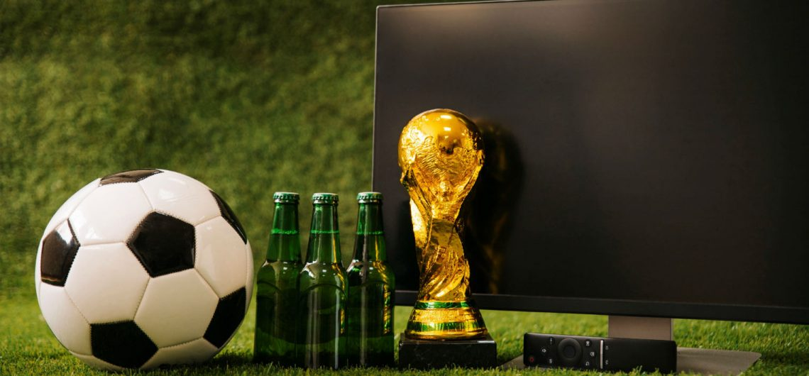 tv, beer bottles, football and a world cup award