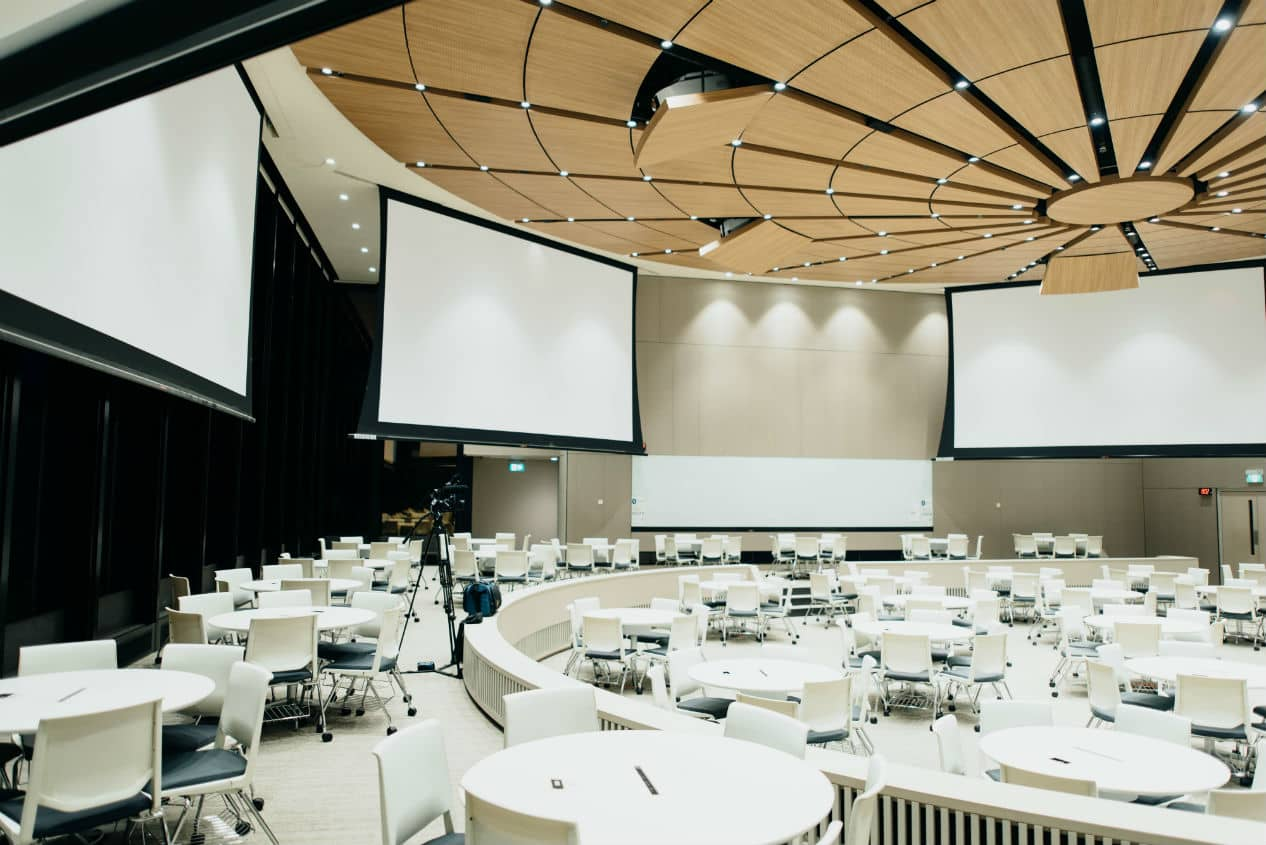 White, round and empty meeting room with many chairs and tables
