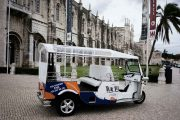 Empty tuk tuk parked in front of Jeronimos Monastery in Lisbon
